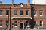 Photo of The Old Customs House pub, formerly a  Royal Naval administrative building, Gunwharf Quays, Portsmouth.