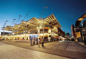 Photo, Gunwharf Quays waterfront at Portsmouth Harbour. 90 designer and outlet stores and great restaurants at Gunwharf Quays in POrtsmouth.
