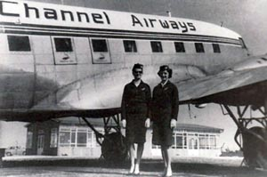 Air hostesses beside a Channel Airways aircraft at Portsmouth Airport